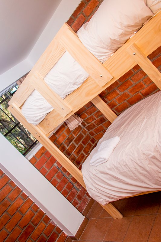 double room cabin with beds and half square at both levels.