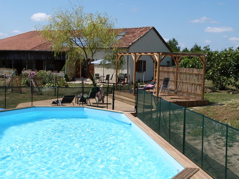 Pool, terraces and gite in background