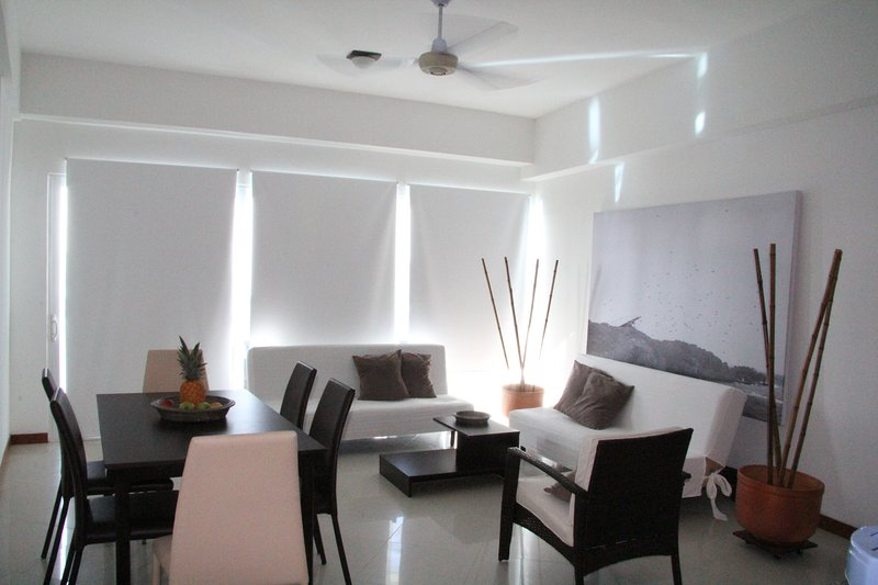 Lounge and dining room with two single sofa beds