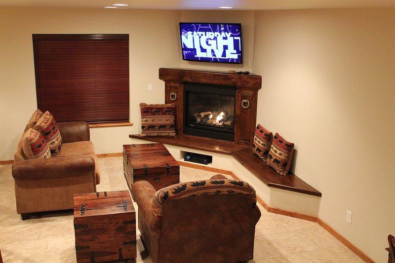 LIVING AREA W/ LARGE FLAT SCREEN TV