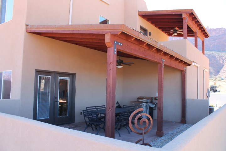 OUTSIDE TOP AND BOTTOM PATIO   BOTTOM PATIO INCLUDES GAS BBQ
