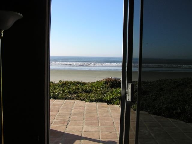 A walk out the sliding glass door to the beach