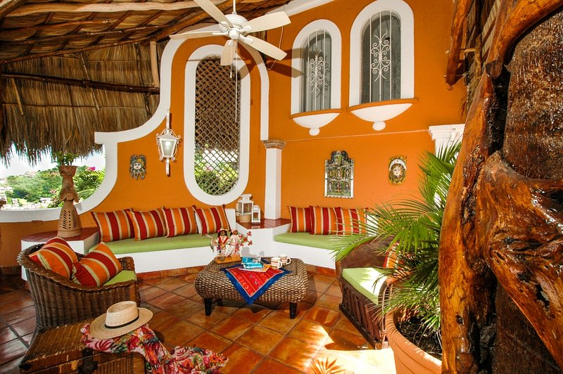 Another spacious living room with views out to the bay and downtown Puerto Vallarta.