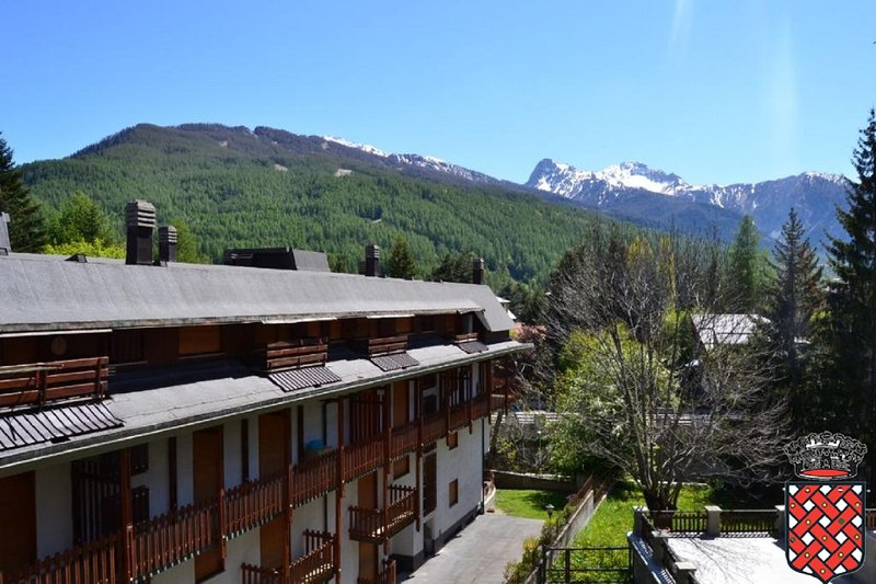 From the sunny balcony overlooking the mountains, ski Colomion