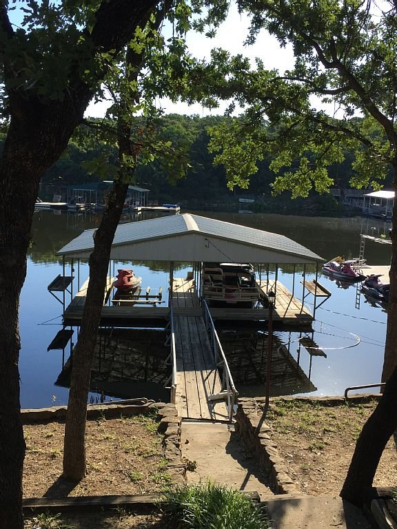 Boat dock with 2 jet ski lifts and boat slip!