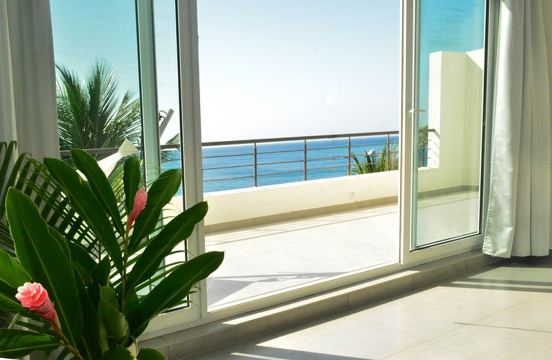 Panoramic ocean view balcony.