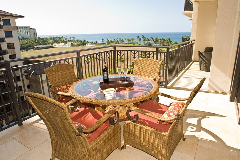Panoramic ocean view from the dining room and lanai in this Oahu beach villa