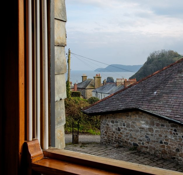 South facing with sea views from your pillow. The harbour is 40 yards down this road.