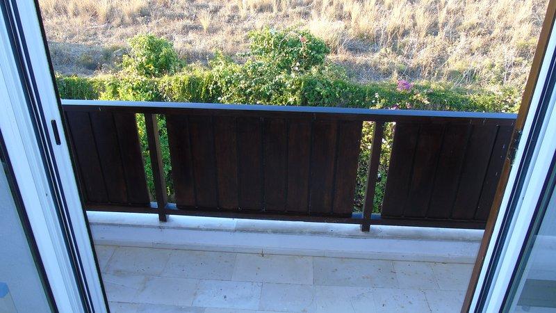 balcón patio trasero con la montaña
