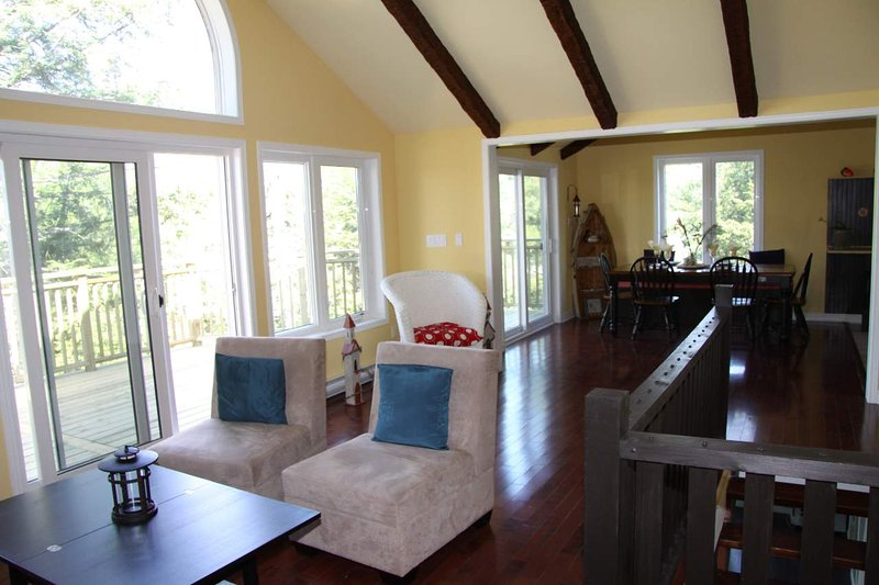 Living and dining area with awesome water views and walk out to deck!