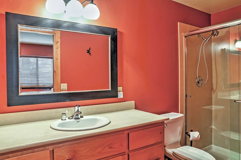 There are 4 bathrooms in the home.