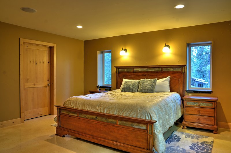 Rest your head in the second master bedroom's king bed.