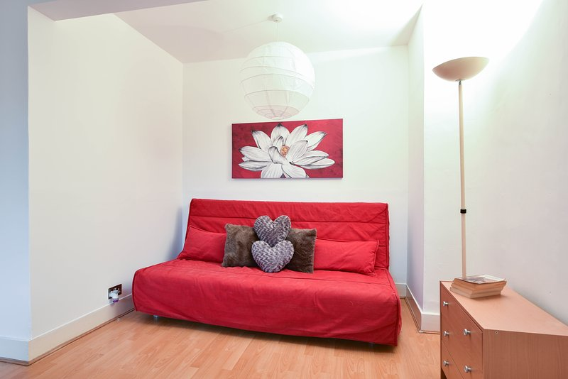 Double bed sitting room, double bed, sofa bed, wardrobe, dimmer lamp,  mirror, bedside cabinet lamp