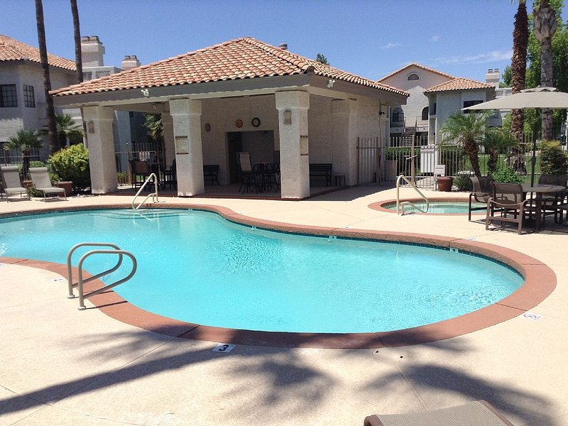 The beautiful heated main pool with hot tub!! Just steps around the corner from unit.