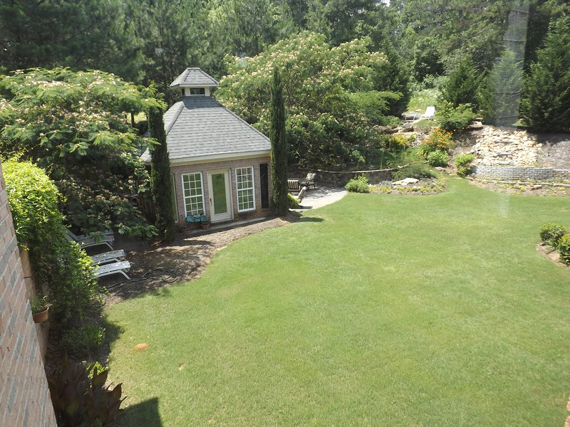 Private courtyard with gazebo, waterfall and aquatic pond