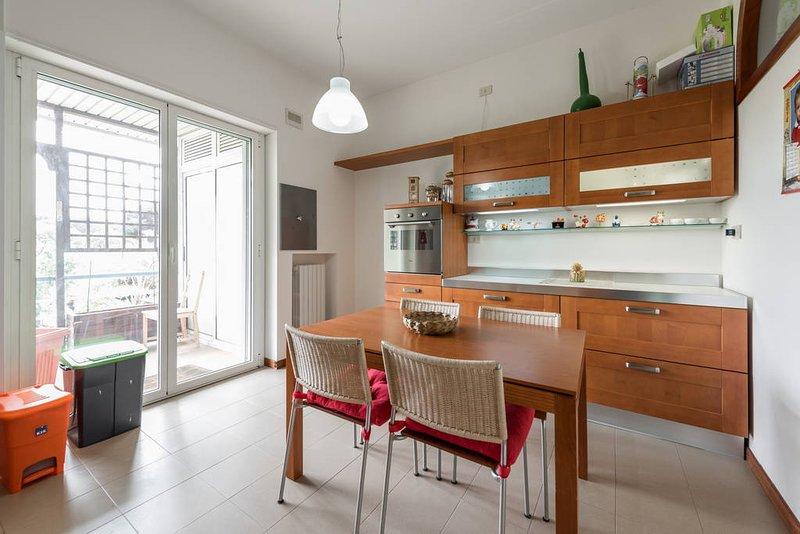 kitchen with balcony and storage