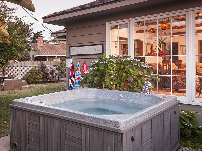 Outdoor Jacuzzi to soothe mere steps from the dining room door + surfer shower.