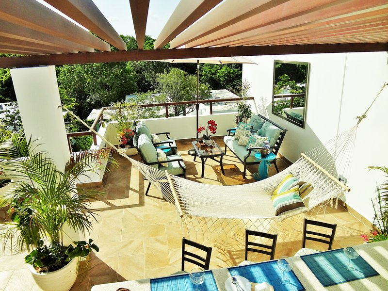A tropical paradise awaits you on your very own private corner penthouse patio