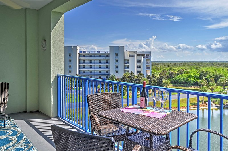 Enjoy pleasant views from the balcony at this New Smyrna Beach vacation rental condo.