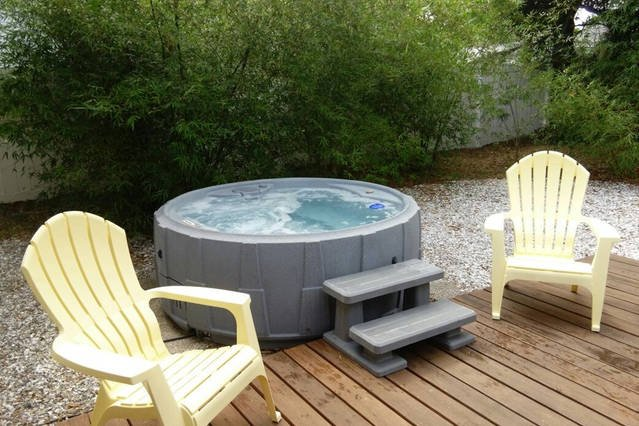 Outdoor living area  - relax in hot tub, cook a meal on the charcoal grill and dine outside.