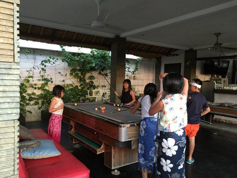 Even kids enjoy play billiard Use sarong n Udeng thats paradise life
