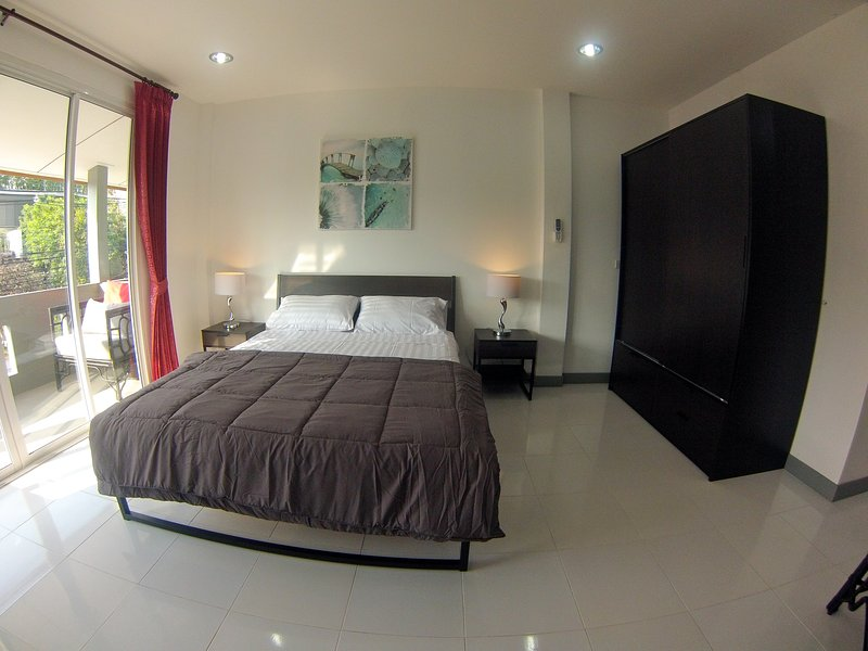 Alternative room view. Bedside tables and lamps & large wardrobe with lockable drawer for valuab