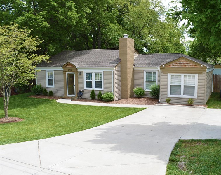 Charming 1 level ranch just 4 miles from the heart of the city with plenty of parking & large Yard!