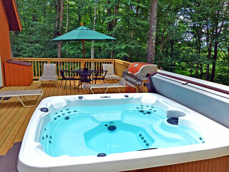 A great escape with amazing deck. hot tub, fire pit, BBQ grill, table and chairs.