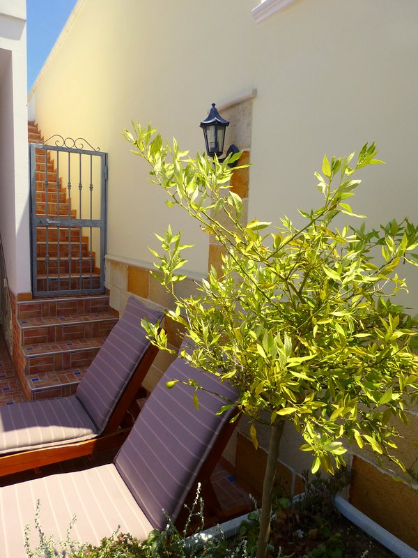 Outdoor staircase leads up to the secluded private roof terrace.