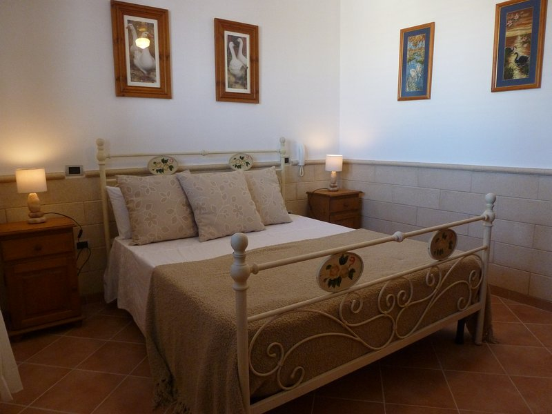 Attractive and comfortable king size Master bedroom with plenty of pillows.