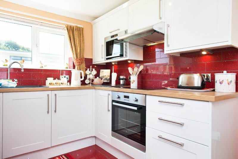 High spec kitchen, including washing machine, freezer and microwave.