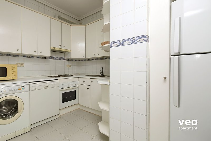 Kitchen well-equipped with utensils and appliances. With oven and washing-machine.