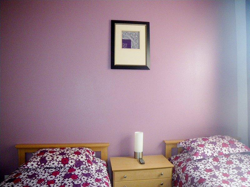 Esquina dormitorio con dos camas
