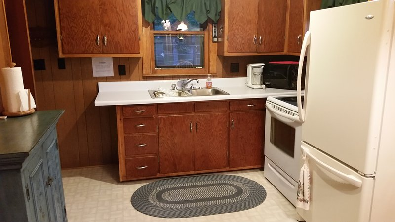 Kitchen view. Includes sink, microwave, coffeemaker, stove/oven, refrigerator.