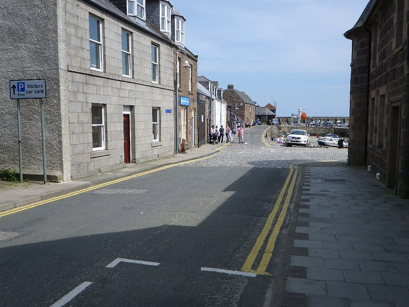 The front of the apartment including entrance, with the slipway to the harbour opposite.