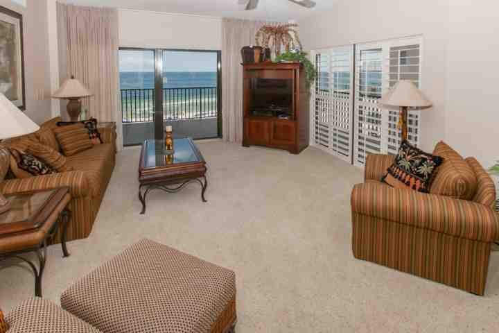 Carpeted living room with views of the Gulf