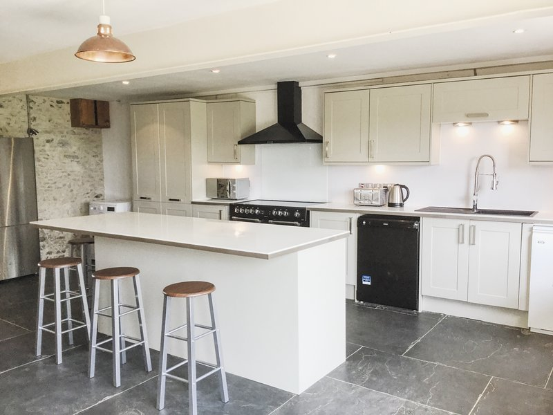 Large high spec family kitchen with central island and range cooker