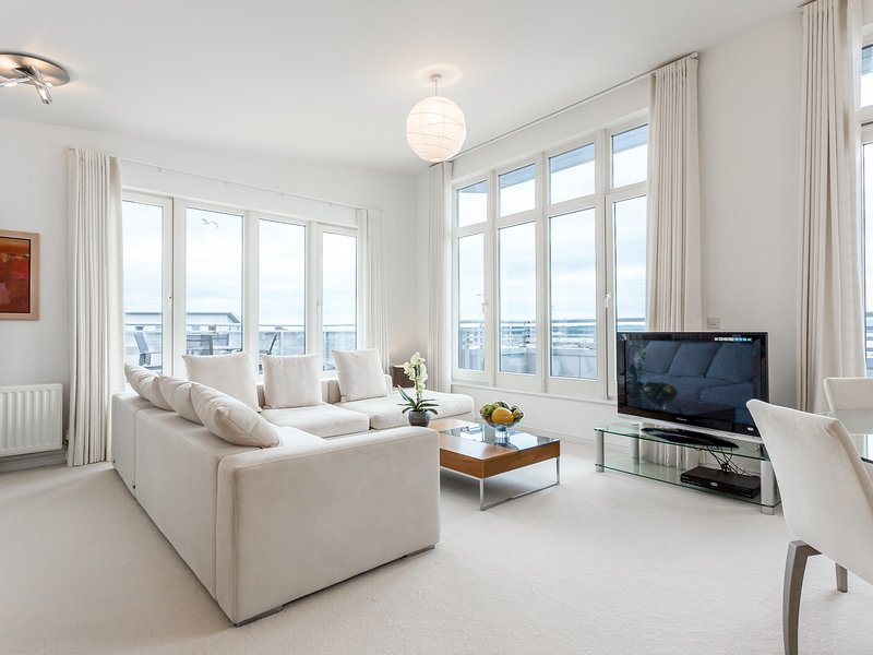 Bright and sunny lounge with stunning panoramic views of Poole Harbour.    A very high spec.. 6