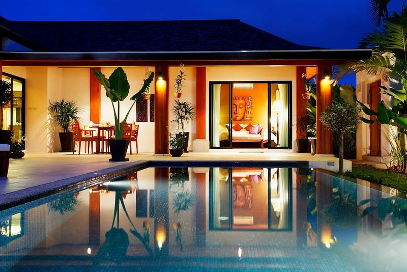 Your tropical pool and terrace by night