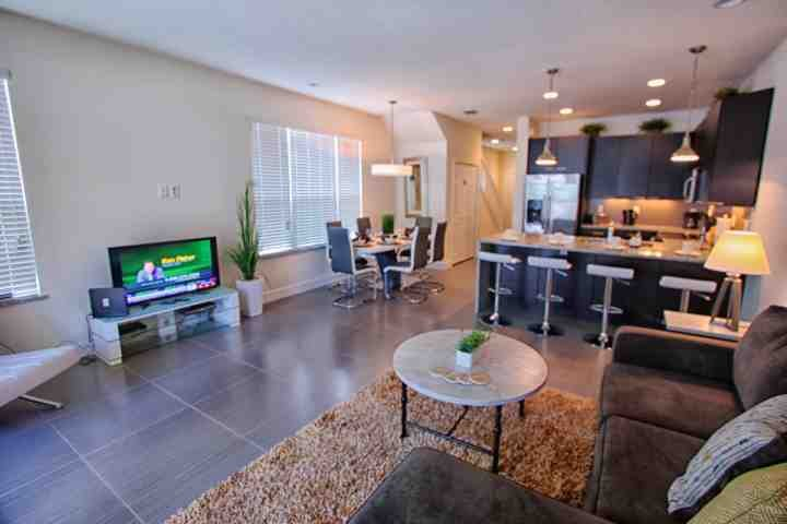 Open Floor Plan - Living Area w/Pool Access, Dining Area & Kitchen