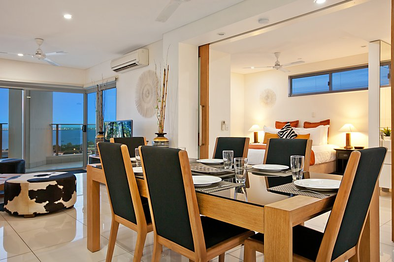 Dining in main living area. Master bedroom in back ground (sliding glass/timber doors to close off)