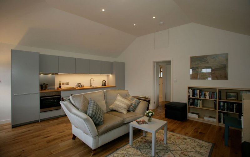 Calm and comfortable, a high ceiling adds to the spaciousness of the main room.