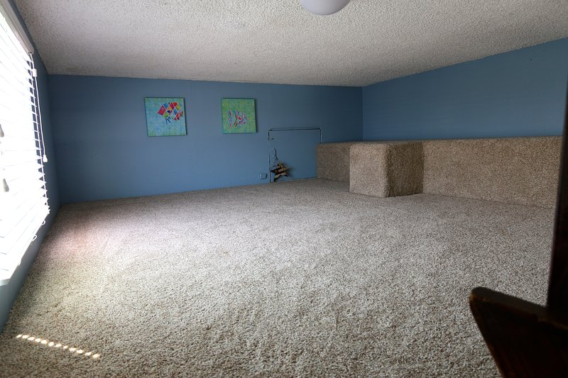 Loft area: a favorite with older kids and teens - you can't stand but plenty of head room if sitting