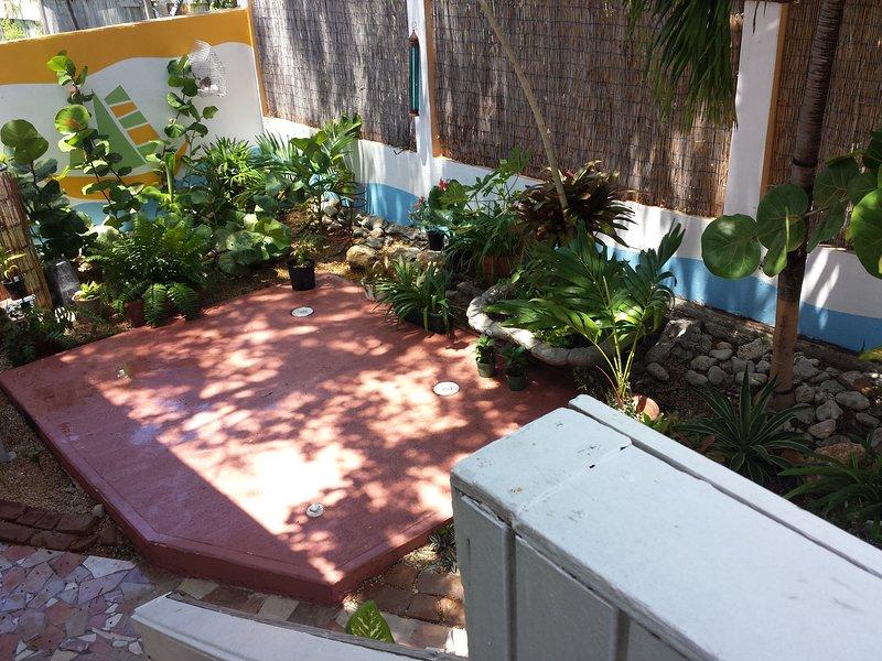 Egen uteplats med tropiska landskap