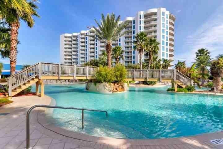 Destin's Premier resort with its lush tropical landscape surrounding its lagoon pool