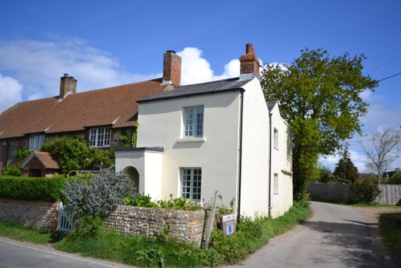 The house at the height of summer showing access to the lane that leads to the Chichester Estuary