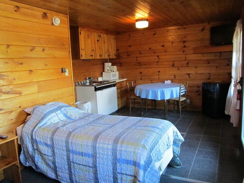 Sleeping area adjacent to kitchenette.