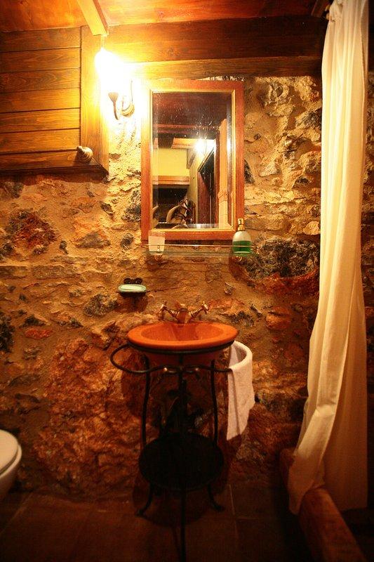 Yellow Bathroom next to small double bedroom