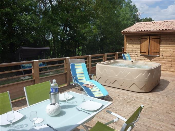 Large deck with spa, garden furniture, deckchairs