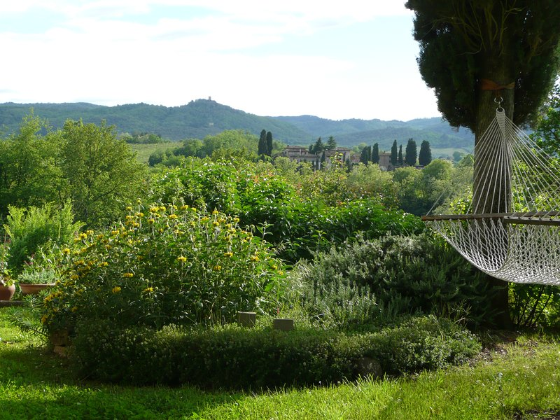 Late spring in Casa Colonica garden + view towards Chianti hills.